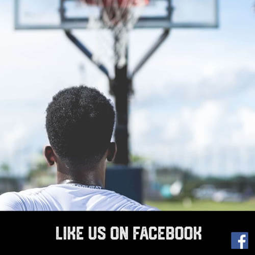 African American teenage boy youth sports basketball player shooting hoops on an outside court
