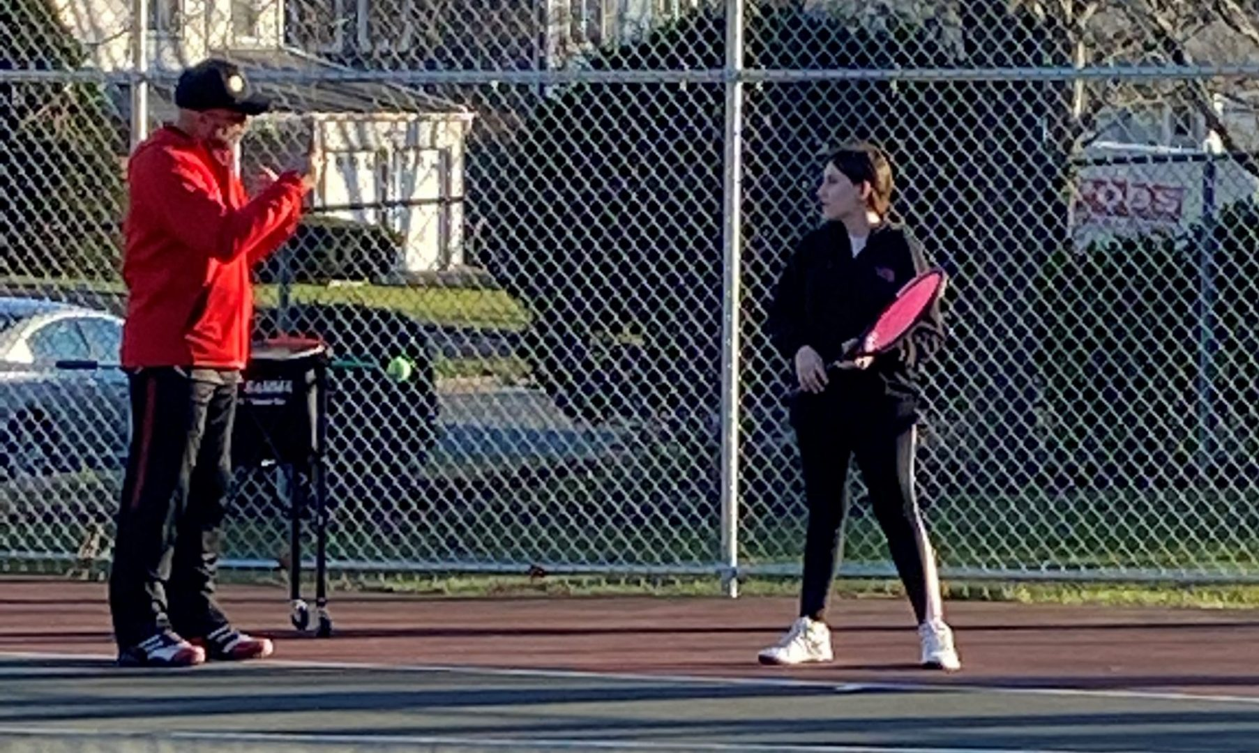 Renee Clark receiving tennis instruction on tennis court at Suffolk County Junior Tennis Association with an All Kids Play youth sports grant