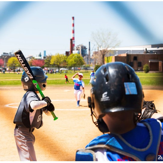 Youth sports baseball player at bat ready to hit a baseball on a baseball field for Newfield Little League in East Bridgeport Connecticut with the All Kids Play financial assistance grant