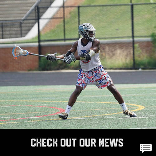 African American teenage boy youth sports lacrosse player passing a lacrosse ball with a stick on a field