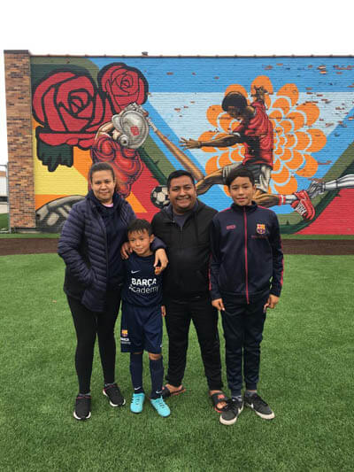 Latinx Porfirio family with two youth sports boy brothers soccer players that play for Barcelona Academy in Chicago Illinois with All Kids Play youth sports financial assistance grant