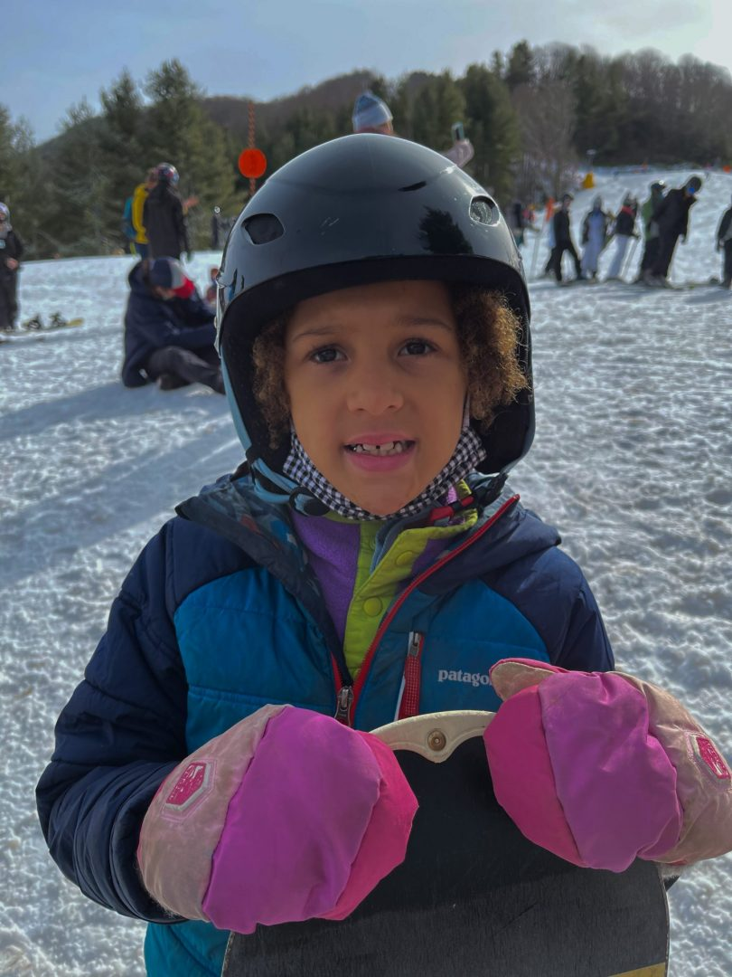 Nola Boone preparing to snowboard at Cataloochee Ski Area with an All Kids Play youth sports grant